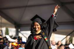 A student celebrates during the 2019 Graduate Commencement Ceremony. Mark Brown/University of St. Thomas
