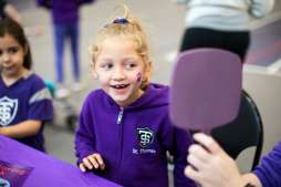 A young Tommie gets her face painted during the Purple on the Plaza event. Liam James Doyle/University of St. Thomas