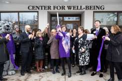 Madonna McDermott, executive director of the Center for Well-Being, cuts a ribbon along with President Julie Sullivan and other administrators, staff, faculty and supporters during the grand opening of the new Center for Well-Being. Mark Brown/University of St. Thomas