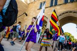 International students carry their flags through the Arches during the March Through the Arches event September 8, 2016.