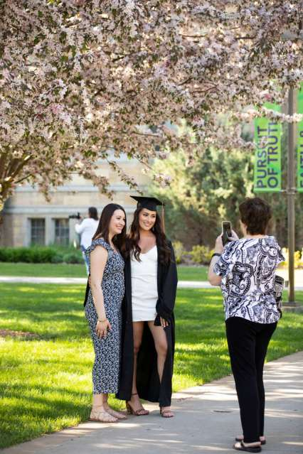 Graduating seniors of the 2020 class return to the St. Paul campus to take photos on a beautiful spring day on May 15, 2020. In-person commencement ceremonies were canceled due to the coronavirus pandemic.