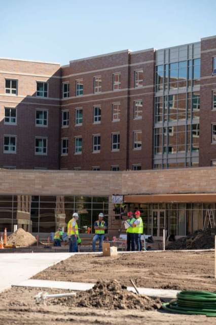 Construction crews work on completing Tommie North Residence Hall.