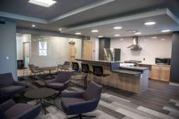 A lounge and food preparation space in Tommie East Residence Hall.
