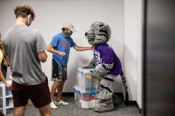 Tommie helps a parent moving a student into Tommie East Residence Hall.