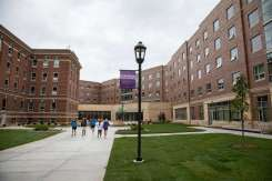 Students walk toward the newly constructed Tommie North Residence Hall.