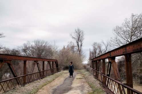 Tiaryn Daniels walks across a bridge at Black Bayou in Glendora, Mississippi, in January during the We March For Justice study tour. The murder of Emmett Till unfolded in the area in 1955. Mark Brown/University of St. Thomas