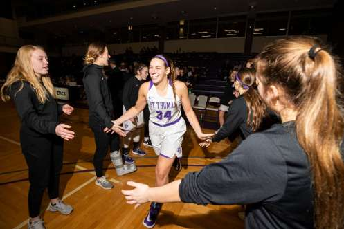 Brynne Rolland runs onto the court on Jan. 22, 2020 at Schoenecker Arena in St. Paul where the University of St. Thomas women's basketball team defeated Macalester with a final score of 63-38. Liam James Doyle/University of St. Thomas