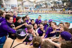 The St. Thomas swim and dive team cheers together during the men's and women's MIAC swimming and diving championship at the U of M Aquatic Center in February. Liam James Doyle/University of St. Thomas
