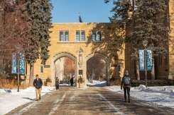 Students walk out of the Arches on a cold winter day. Mark Brown/University of St. Thomas