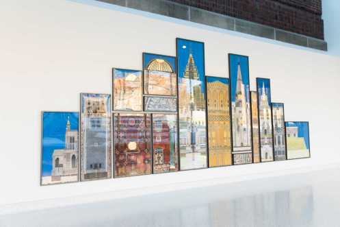 """""""Tell Me a Story"""" by Minnesota artist Mary Griep, 2020. 204"""" wide by 80"""" tall. Fifteen details from sacred buildings of several religious traditions across the world serve to uphold the multifaith nature of the Iversen Center for Faith. (Mark Brown/University of St. Thomas)"""