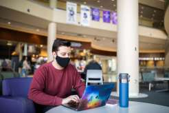 Noah Becker, freshman and member of Undergraduate Student Government (USG), participates in a virtual USG senate meeting in the Anderson Student Center. Liam James Doyle/University of St. Thomas