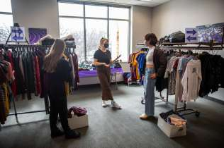 Co-Founders Morgan Ronsen, middle, and Payton Filipiak, right, at Tommie's Closet, a student-led clothing exchange, created by Ashoka Changemaker students. Mark Brown/University of St. Thoma