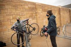 Students get their bikes tuned up by workers with the Bicycle Alliance of Minnesota during an event hosted by the Sustainability Club. Liam James Doyle/University of St. Thomas