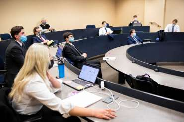Student members of the Aristotle Fund hold a team meeting in McNeely Hall. Liam James Doyle/University of St. Thomas