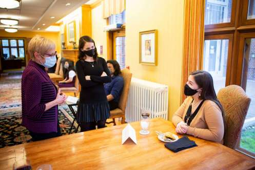 Habiger Latino Scholars mingle a a dinner with President Julie Sullivan in Sitzmann Hall. Jamie Tjornehoj/University of St. Thomas