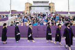 Students from the School of Law's Class of 2020 walk into O'Shaughnessy Stadium at the beginning of their Commencement ceremony. Liam James Doyle/University of St. Thomas
