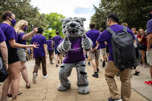 Tommie greets students during the annual March Out of the Arches event. Mark Brown/University of St. Thomas