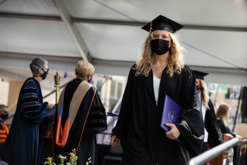 A student walks across the stage during the Opus College of Business undergraduate commencement ceremony. Mark Brown/University of St. Thomas