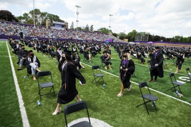Students attend the Opus College of Business undergraduate commencement ceremony. Mark Brown/University of St. Thomas