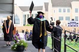 Students receive their diplomas during the graduate commencement ceremony. Mark Brown/University of St. Thomas