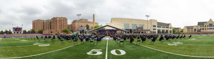 A panorama image of the commencement ceremony for graduate programs. Mark Brown/University of St. Thomas