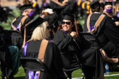 A student smiles during the commencement ceremony for graduate programs in the Opus College of Business and School of Engineering. Mark Brown/University of St. Thomas
