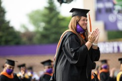 A student applauds a speech during the commencement ceremony for graduate programs in the Opus College of Business and School of Engineering. Mark Brown/University of St. Thomas