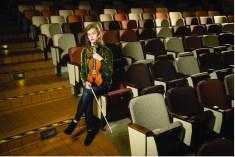 Vivian Murphy with a violin.