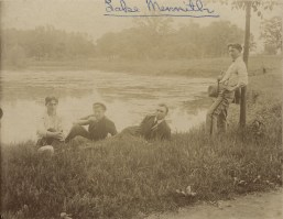College of St. Thomas students lounging on the shores of Lake Mennith, 1905.