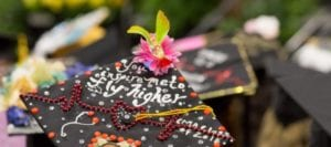 """Graduation cap with text """"You inspire me to fly higher"""""""