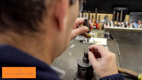 Ring being positioned for hallmarking stamp