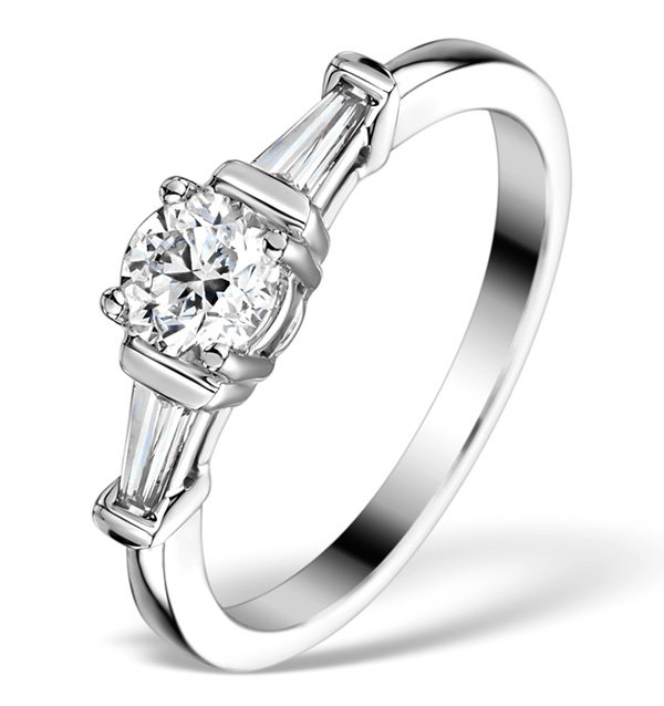 Alex Jones style vintage engagement ring with baguette cut diamonds around a round cut solitaire