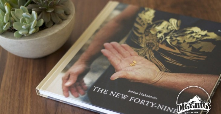 Cover of the New Forty-Niners book, featuring a man holding three nuggets of gold.