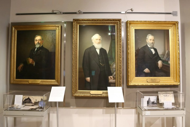 Portraits of founders Henry Wells (1805-1878) and William G. Fargo (1818-1881) aside later owner Isaias W. Hellman (1842-1920).