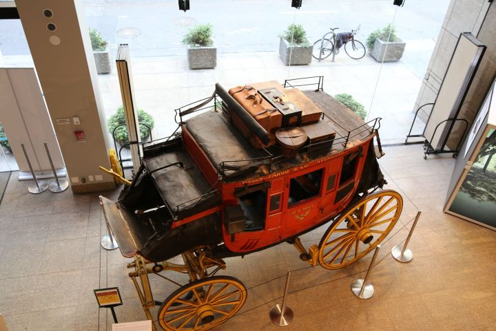 View of the Wells Fargo stage coach and the glass walls separating the museum interior from the street front.  More concrete planters have been added between the street and sidewalk since the theft.
