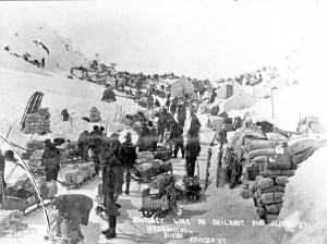 Miners organize provisions along the summit of Chilkoot Pass.  It would take multiple trips to move the massive amount of provisions each miner would need to survive in the forbidding Klondike gold fields.