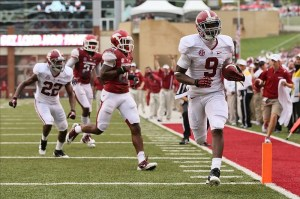 Sep 15, 2012; Fayetteville, AR, USA; Alabama Crimson Tide wide receiver Amari Cooper (9) runs after a catch for a touchdown against the Arkansas Razorbacks during the second quarter at Donald W. Reynolds Razorback Stadium. Mandatory Credit: Nelson Chenault-US PRESSWIRE