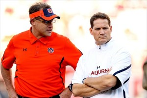 Happier Times: Oct 8, 2011; Fayetteville, AR, USA; Auburn Tigers offensive coordinator Gus Malzahn and head coach Gene Chizik talks prior to the game against the Arkansas Razorbacks at Donald W. Reynolds Razorback Stadium. (Nelson Chenault-USA TODAY Sports)