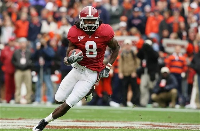Nov 26, 2010; Tuscaloosa, AL, USA; Alabama Crimson Tide wide receiver Julio Jones (8) carries the ball against the Auburn Tigers at Bryant-Denny Stadium. Mandatory Credit: Marvin Gentry-USA TODAY Sports
