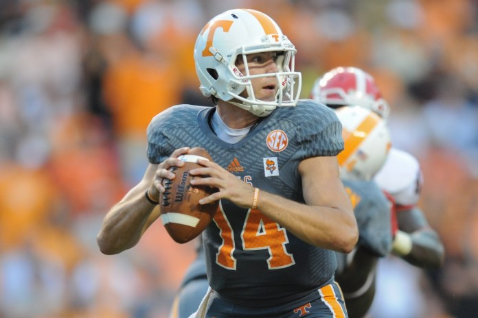 Oct 5, 2013; Knoxville, TN, USA; Tennessee Volunteers quarterback Justin Worley (14) during the second half against the Georgia Bulldogs at Neyland Stadium. Georgia won in overtime 34 to 31. Mandatory Credit: Randy Sartin-USA TODAY Sports