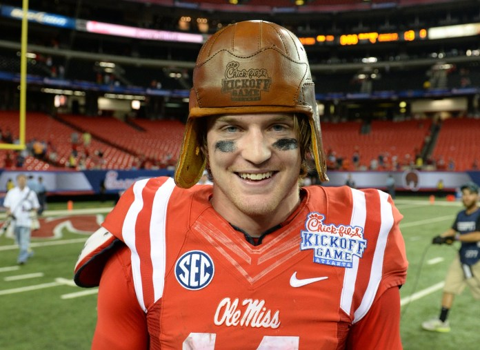 Aug 28, 2014; Atlanta, GA, USA; Mississippi Rebels quarterback Bo Wallace (14) wears the old leather helmet after defeating the Boise State Broncos in the 2014 Chick-fil-A kickoff game at the Georgia Dome. Rebels won 35-13. Mandatory Credit: John David Mercer-USA TODAY Sports