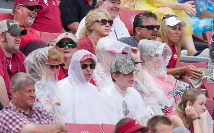 Sep 6, 2014; Tuscaloosa, AL, USA; Alabama Crimson Tide fans watch the game against the Florida Atlantic Owls in the rain and with time left on the clock the game was called with Alabama winning 41-0 over Florida Atlantic at Bryant-Denny Stadium. Mandatory Credit: Marvin Gentry-USA TODAY Sports