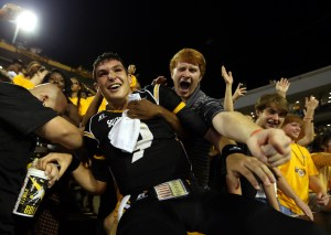 Sep 6, 2014; Hattiesburg, MS, USA; Southern Miss Golden Eagles quarterback Nick Mullens (9) celebrates with fans after their 26-20 win over the Alcorn State Braves at M.M. Roberts Stadium. Mandatory Credit: Chuck Cook-USA TODAY Sports