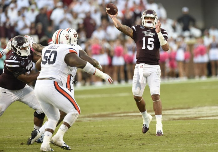 Oct 11, 2014; Starkville, MS, USA; Mississippi State Bulldogs quarterback Dak Prescott (15) passing against the Auburn Tigers during the fourth quarter at Davis Wade Stadium. Mississippi State defeated Auburn 38-23. Mandatory Credit: John David Mercer-USA TODAY Sports
