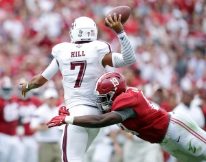 Oct 18, 2014; Tuscaloosa, AL, USA; Alabama Crimson Tide linebacker Reggie Ragland (19) puts pressure on Texas A&M Aggies quarterback Kenny Hill (7) at Bryant-Denny Stadium. Mandatory Credit: Marvin Gentry-USA TODAY Sports