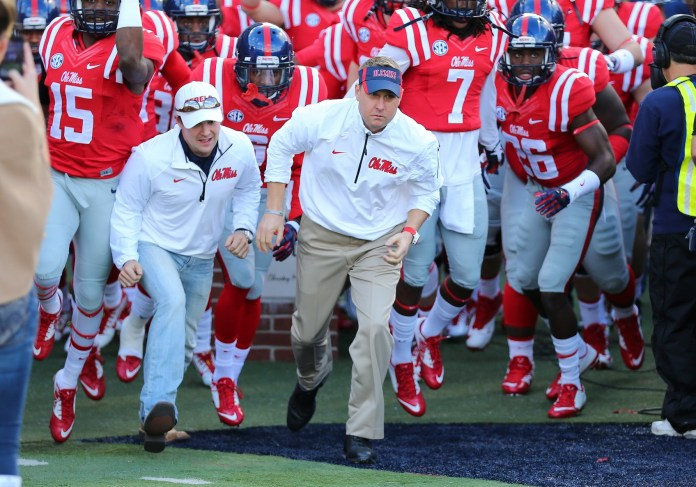 Nov 29, 2014; Oxford, MS, USA; Mississippi Rebels head coach Hugh Freeze leads the Mississippi Rebels onto the field before the game against the Mississippi State Bulldogs at Vaught-Hemingway Stadium. Mandatory Credit: Spruce Derden-USA TODAY Sports