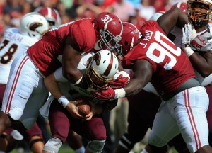 Sep 26, 2015; Tuscaloosa, AL, USA; Alabama Crimson Tide linebacker Denzel Devall (30) and defensive lineman Jarran Reed (90) tackle Louisiana Monroe Warhawks quarterback Garrett Smith (13) at Bryant-Denny Stadium. Mandatory Credit: Marvin Gentry-USA TODAY Sports