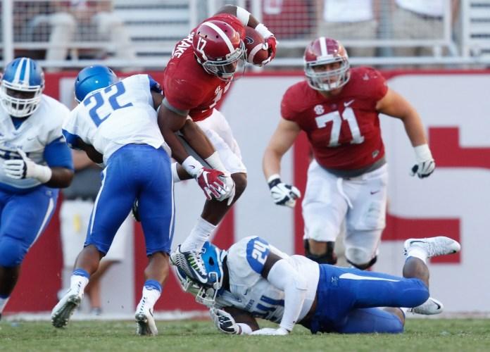 Sep 12, 2015; Tuscaloosa, AL, USA; Alabama Crimson Tide running back Kenyan Drake (17) is hit by Middle Tennessee Blue Raiders safety Quay Watt (22) at Bryant-Denny Stadium. Mandatory Credit: Marvin Gentry-USA TODAY Sports