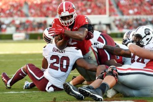 Sep 19, 2015; Athens, GA, USA; Georgia Bulldogs running back Nick Chubb (27) scores a touchdown over South Carolina Gamecocks safety T.J. Gurley (20) during the first half at Sanford Stadium. Mandatory Credit: Dale Zanine-USA TODAY Sports