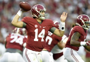 Oct 10, 2015; Tuscaloosa, AL, USA; Alabama Crimson Tide quarterback Jake Coker (14) rolls out to pass against the Arkansas Razorbacks during the first quarter at Bryant-Denny Stadium. Mandatory Credit: John David Mercer-USA TODAY Sports